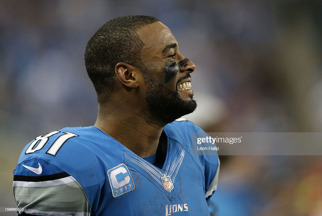 Calvin Johnson #81 of the Detroit Lions smiles on the sidelines after breaking the NFL single season yardage record formally held by Jerry Rice during the game against the Atlanta Falcons at Ford Field on December 22, 2012 in Detroit, Michigan. The Falcons defeated the Lions 31-18.