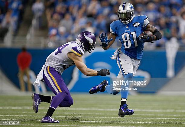 Calvin Johnson of the Detroit Lions tries to avoid the tackle by Andrew Sendejo of the Minnesota Vikings in the third quarter at Ford Field on...