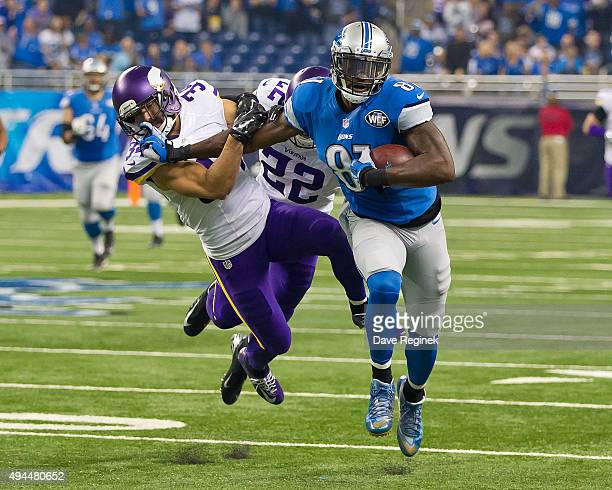 Calvin Johnson of the Detroit Lions tries to avoid the tackle by Andrew Sendejo of the Minnesota Vikings in the first half during an NFL game at Ford...