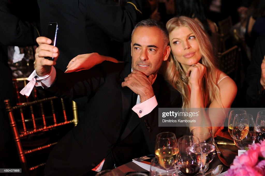 Calvin Klein Collection designer Francisco Costa and Fergie Duhamel take selfies as they attend the amfAR Inspiration Gala New York 2014 at The Plaza Hotel on June 10, 2014 in New York City.