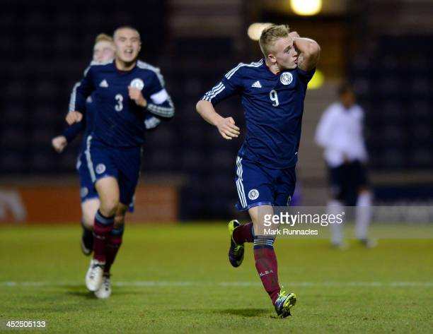 Calvin Miller of Scotland U16 celebrates scores the opening goal of the games and celebrates with his team mates during the Sky Sports Victory Shield...