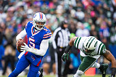 Calvin Pace of the New York Jets pursues a scrambling Tyrod Taylor of the Buffalo Bills during the first half on January 3 2016 at Ralph Wilson...