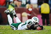 Calvin Pace of the New York Jets recovers the ball on a fumble by Rex Grossman of the Washington Redskins during a game at FedExField on December 4...