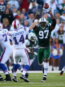 Calvin Pace of the New York Jets rushes in to pressure Ryan Fitzpatrick of the Buffalo Bills at Ralph Wilson Stadium on November 6 2011 in Orchard...