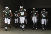 Calvin Pace of the New York Jets takes the field for the game against the Cincinnati Bengals at Paul Brown Stadium on August 16 2014 in Cincinnati...