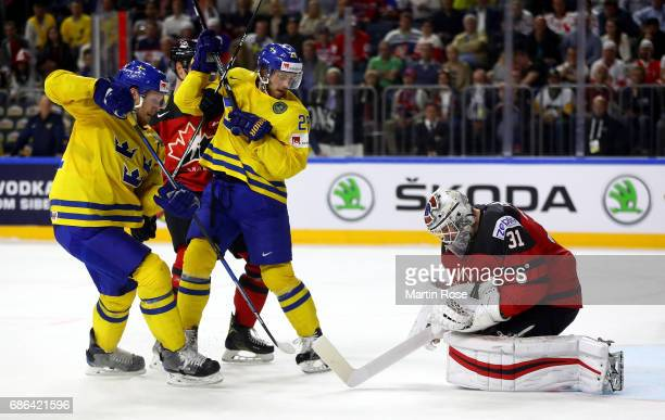 Calvin Pickard goaltender of Canada makes a save on Elias Lindholm of Sweden during the 2017 IIHF Ice Hockey World Championship Gold Medal game...