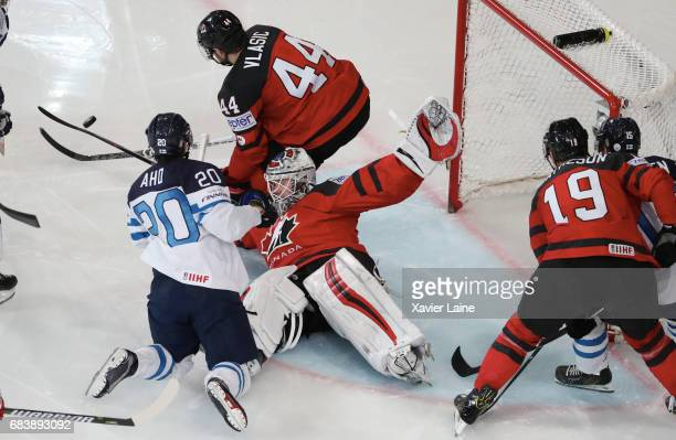 Calvin Pickard of Canada stop the puck over Sebastian Aho of Finland during the 2017 IIHF Ice Hockey World Championship game between Canada and...