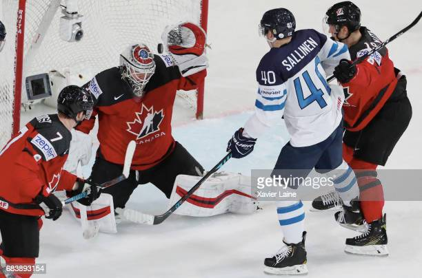 Calvin Pickard of Canada stop the puck over Tomi Sallinen of Finland during the 2017 IIHF Ice Hockey World Championship game between Canada and...