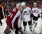 Calvin Pickard of the Colorado Avalanche celebrates their 21 shootout win over the Detroit Red Wings with teammate Zach Redmond during a NHL game on...