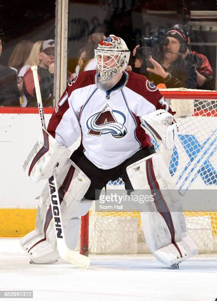 Calvin Pickard of the Colorado Avalanche gets ready to make a save against the Arizona Coyotes at Gila River Arena on March 13 2017 in Glendale...