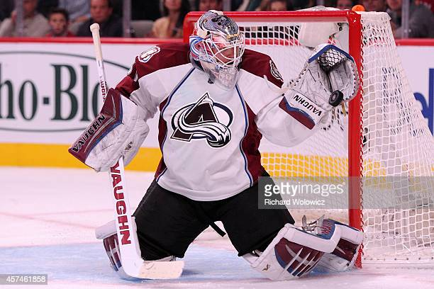 Calvin Pickard of the Colorado Avalanche makes a glove save on the puck during the NHL game against the Montreal Canadiens at the Bell Centre on...