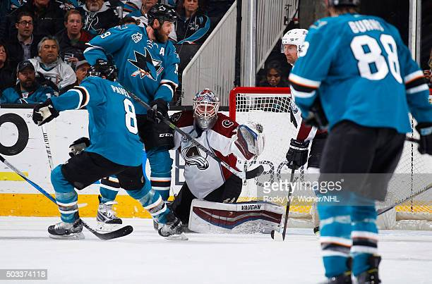 Calvin Pickard of the Colorado Avalanche protects the net against Joe Thornton and Joe Pavelski of the San Jose Sharks at SAP Center on December 28...