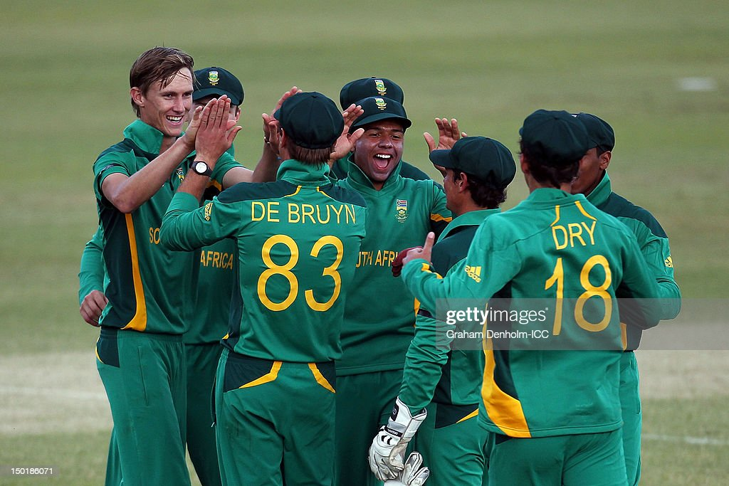 Calvin Savage of South Africa (L) celebrates with team mates after dismissing Asif Ahmed of Bangladesh during the ICC U19 Cricket World Cup 2012 match between South Africa and Bangladesh at Allan Border Field on August 12, 2012 in Brisbane, Australia.