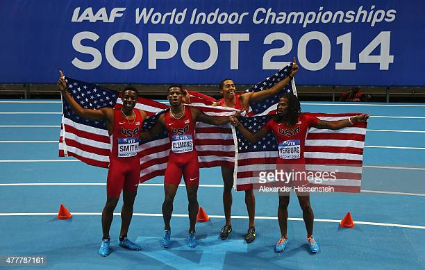 Calvin Smith Kyle Clemons Kind Butler III and David Verburg of the United States pose after winning the gold medal in a new indoor world record time...