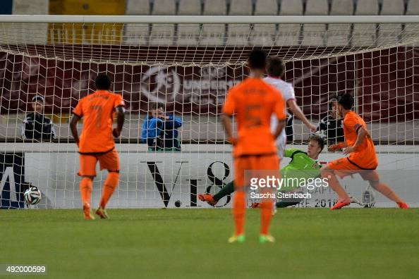 Calvin Verdonk of Netherlands scores the opening goal from a penalty during the UEFA Under17 European Championship 2014 semi final match between...