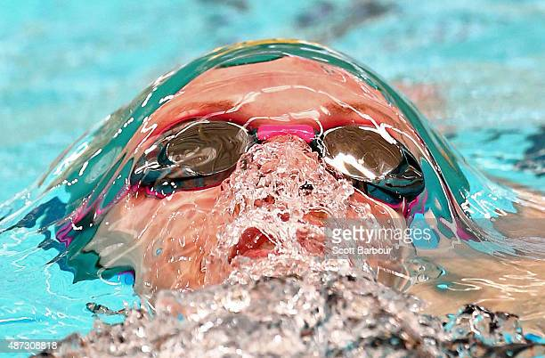 Calypso Sheridan of Australia emerges from underwater as she competes in the Women's 200m Backstroke preliminaries at the Aquatic Centre of the...