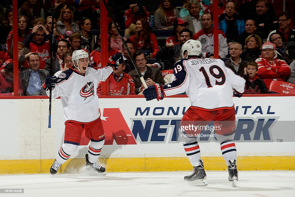 <a gi-track='captionPersonalityLinkClicked' href=/galleries/search?phrase=Cam+Atkinson&family=editorial&specificpeople=6270272 ng-click='$event.stopPropagation()'>Cam Atkinson</a> #13 celebrates with <a gi-track='captionPersonalityLinkClicked' href=/galleries/search?phrase=Ryan+Johansen&family=editorial&specificpeople=6698841 ng-click='$event.stopPropagation()'>Ryan Johansen</a> #19 of the Columbus Blue Jackets after scoring a goal in the third period during an NHL game against the Washington Capitals at Verizon Center on November 12, 2013 in Washington, DC.