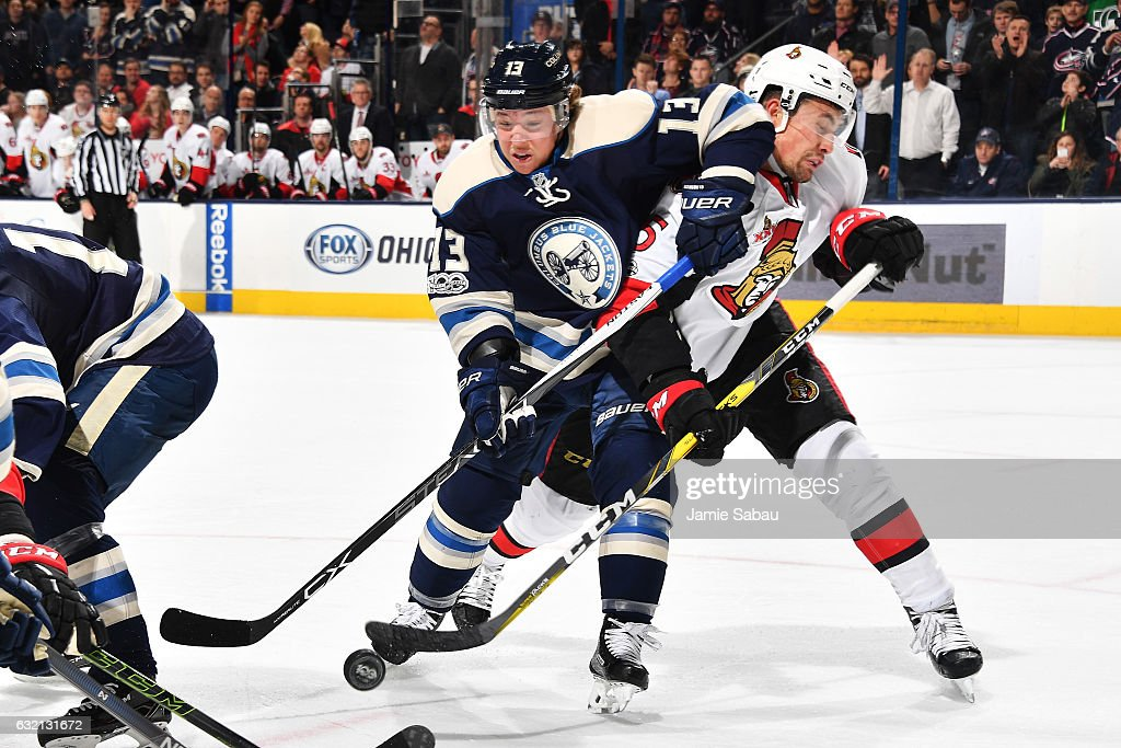 Cam Atkinson #13 of the Columbus Blue Jackets and Cody Ceci #5 of the Ottawa Senators battle for the puck following a face-off during the third period of a game on January 19, 2017 at Nationwide Arena in Columbus, Ohio. Ottawa shutout Columbus 2-0.