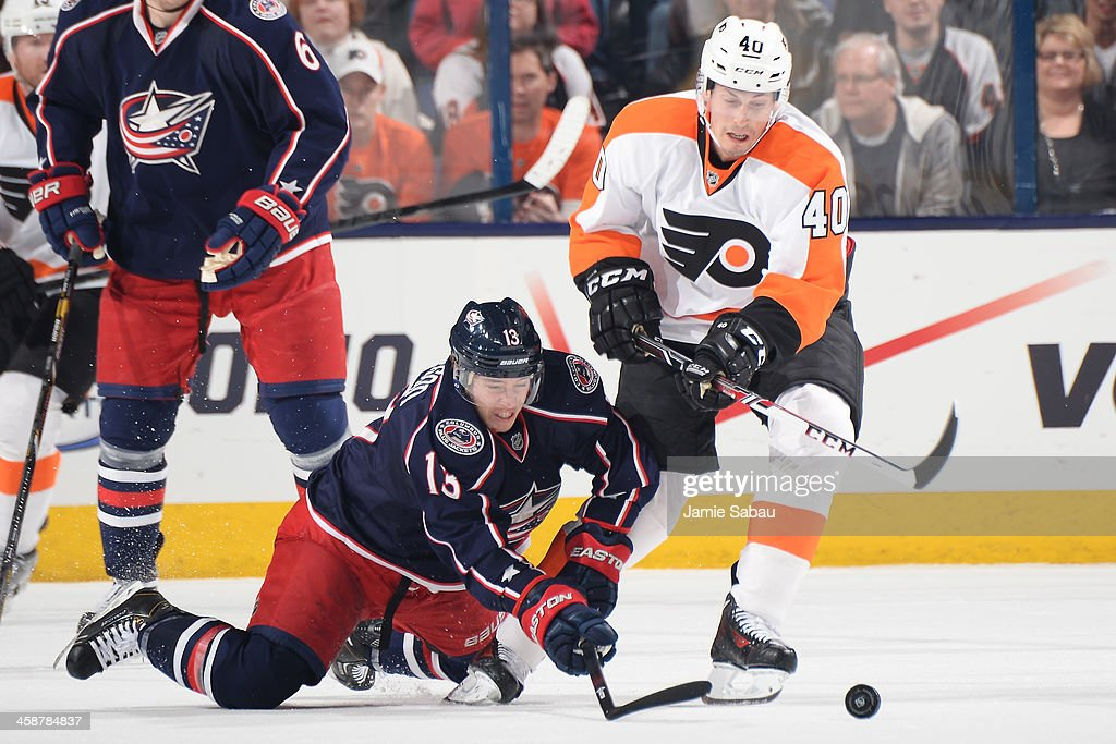 <a gi-track='captionPersonalityLinkClicked' href=/galleries/search?phrase=Cam+Atkinson&family=editorial&specificpeople=6270272 ng-click='$event.stopPropagation()'>Cam Atkinson</a> #13 of the Columbus Blue Jackets and <a gi-track='captionPersonalityLinkClicked' href=/galleries/search?phrase=Vincent+Lecavalier&family=editorial&specificpeople=201915 ng-click='$event.stopPropagation()'>Vincent Lecavalier</a> #40 of the Philadelphia Flyers battle for a loose puck during the third period on December 21, 2013 at Nationwide Arena in Columbus, Ohio. Columbus defeated Philadelphia 6-3.