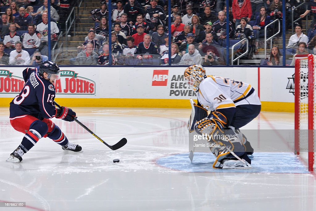 <a gi-track='captionPersonalityLinkClicked' href=/galleries/search?phrase=Cam+Atkinson&family=editorial&specificpeople=6270272 ng-click='$event.stopPropagation()'>Cam Atkinson</a> #13 of the Columbus Blue Jackets attempts to score on goaltender <a gi-track='captionPersonalityLinkClicked' href=/galleries/search?phrase=Chris+Mason+-+Ice+Hockey+Player&family=editorial&specificpeople=171262 ng-click='$event.stopPropagation()'>Chris Mason</a> #30 of the Nashville Predators during the third period on April 27, 2013 at Nationwide Arena in Columbus, Ohio. Columbus defeated Nashville 3-1.