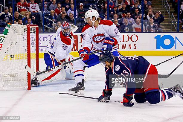 Cam Atkinson of the Columbus Blue Jackets beats Jeff Petry of the Montreal Canadiens and Al Montoya of the Montreal Canadiens for a goal during the...