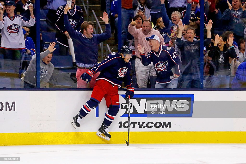 Cam Atkinson of the Columbus Blue Jackets celebrates after beating Henrik Lundqvist of the New York Rangers for a goal during the second period on...