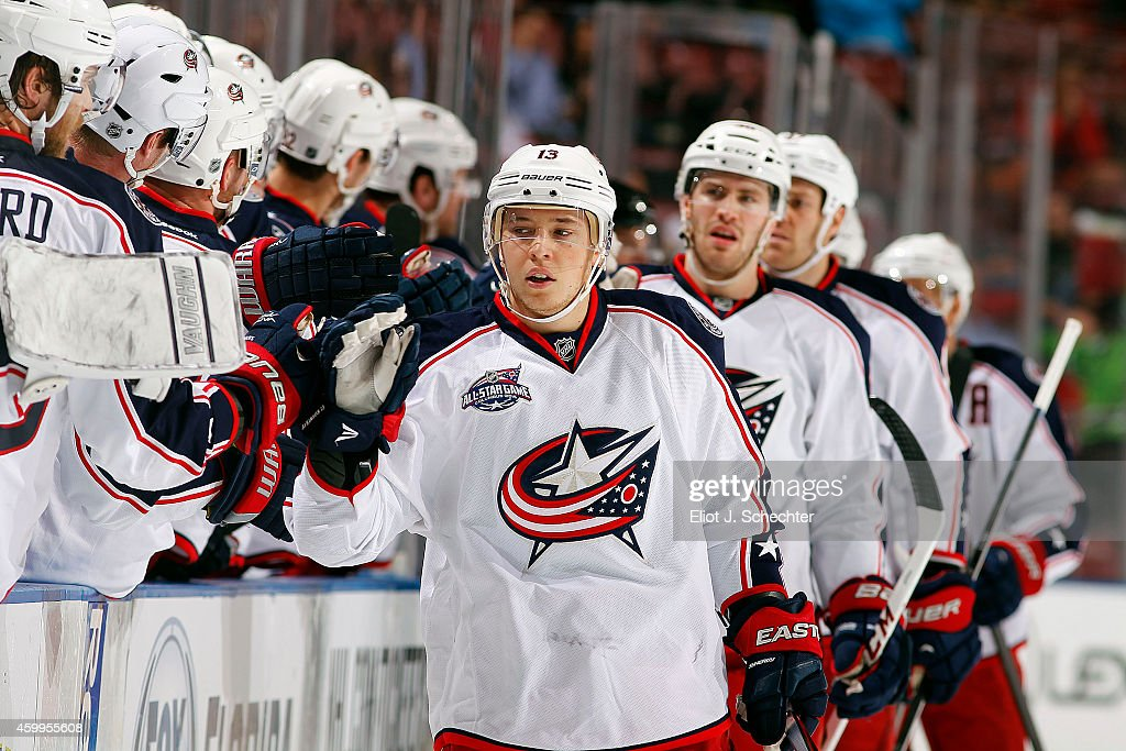 Cam Atkinson of the Columbus Blue Jackets celebrates his goal with teammates against the Florida Panthers during the first period at the BBT Center...