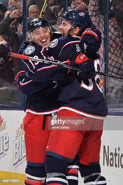 Cam Atkinson of the Columbus Blue Jackets celebrates his hat trick goal with teammate Boone Jenner of the Columbus Blue Jackets during the third...