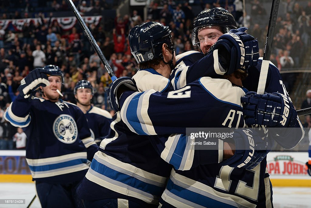 <a gi-track='captionPersonalityLinkClicked' href=/galleries/search?phrase=Cam+Atkinson&family=editorial&specificpeople=6270272 ng-click='$event.stopPropagation()'>Cam Atkinson</a> #13 of the Columbus Blue Jackets celebrates his third period goal will teammates <a gi-track='captionPersonalityLinkClicked' href=/galleries/search?phrase=Brandon+Dubinsky&family=editorial&specificpeople=2271907 ng-click='$event.stopPropagation()'>Brandon Dubinsky</a> #17 of the Columbus Blue Jackets and <a gi-track='captionPersonalityLinkClicked' href=/galleries/search?phrase=Ryan+Johansen&family=editorial&specificpeople=6698841 ng-click='$event.stopPropagation()'>Ryan Johansen</a> #19 of the Columbus Blue Jackets on November 9, 2013 at Nationwide Arena in Columbus, Ohio. Columbus defeated New York 5-2.