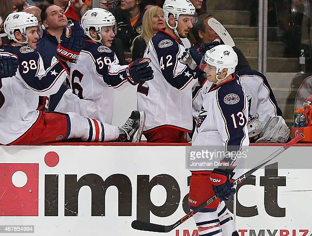 Cam Atkinson of the Columbus Blue Jackets celebrates with teammates after scoring empty net goal in the third period for a hattrick against the...