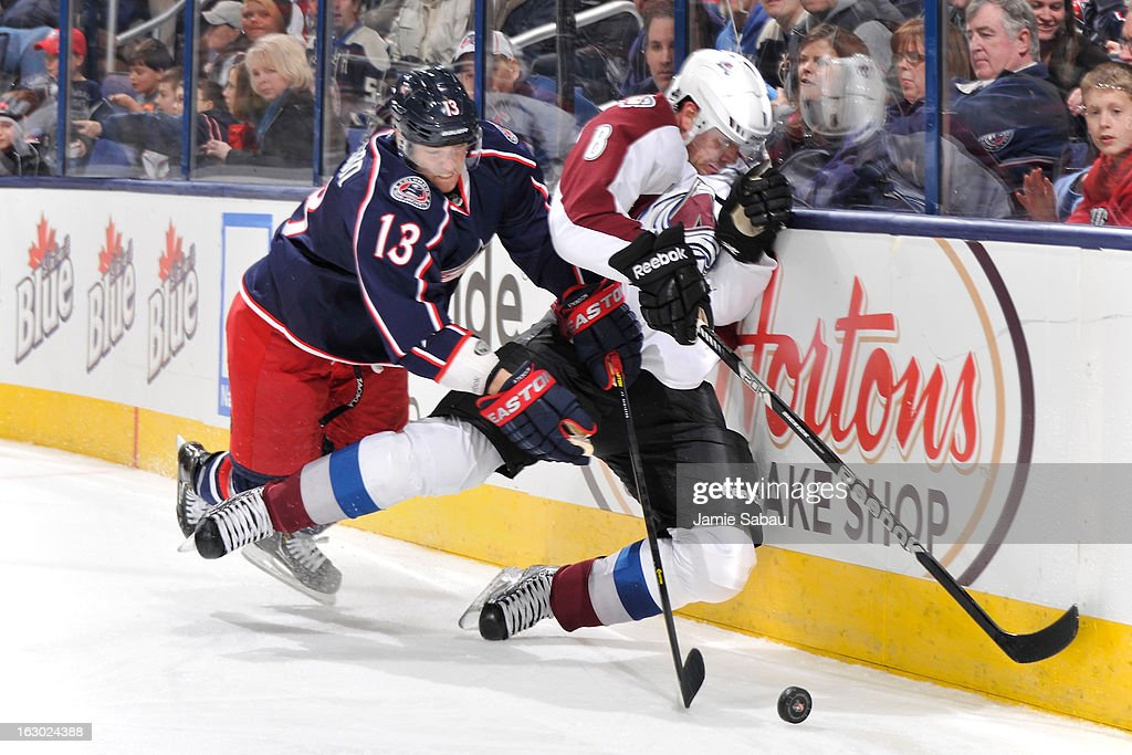 <a gi-track='captionPersonalityLinkClicked' href=/galleries/search?phrase=Cam+Atkinson&family=editorial&specificpeople=6270272 ng-click='$event.stopPropagation()'>Cam Atkinson</a> #13 of the Columbus Blue Jackets checks <a gi-track='captionPersonalityLinkClicked' href=/galleries/search?phrase=Jan+Hejda&family=editorial&specificpeople=624333 ng-click='$event.stopPropagation()'>Jan Hejda</a> #8 of the Colorado Avalanche off the puck in the third period on March 3, 2013 at Nationwide Arena in Columbus, Ohio. Columbus defeated Colorado 2-1 in overtime.
