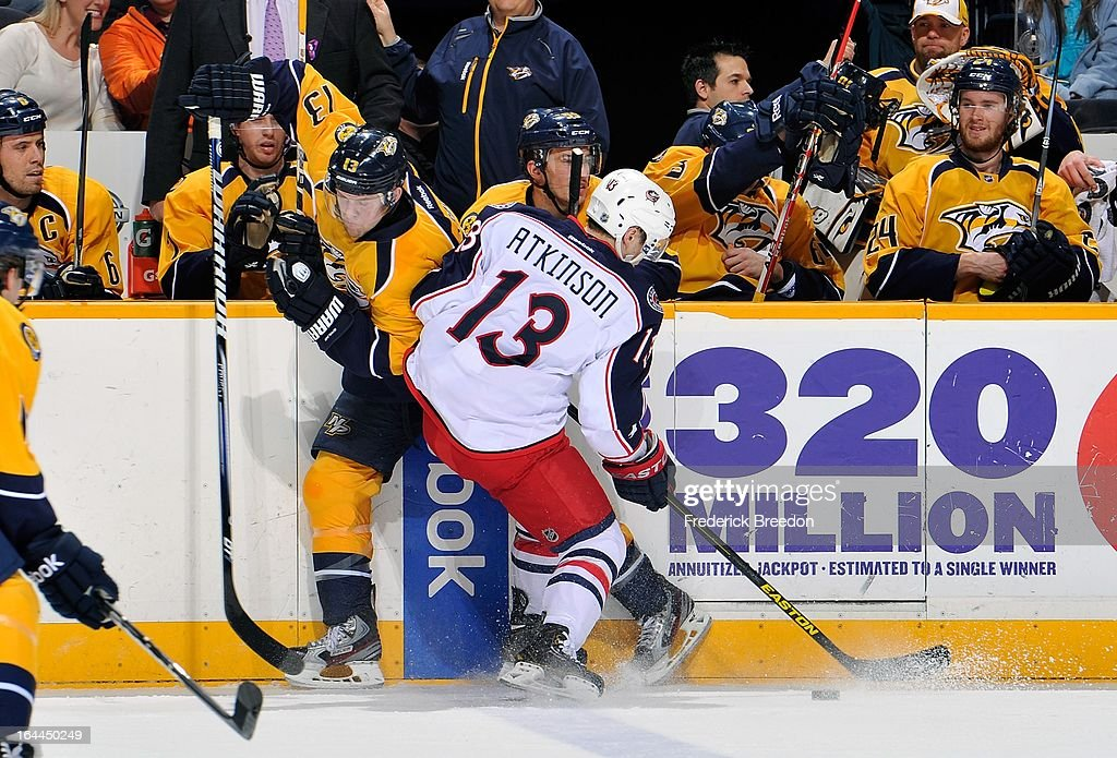 <a gi-track='captionPersonalityLinkClicked' href=/galleries/search?phrase=Cam+Atkinson&family=editorial&specificpeople=6270272 ng-click='$event.stopPropagation()'>Cam Atkinson</a> #13 of the Columbus Blue Jackets collides with <a gi-track='captionPersonalityLinkClicked' href=/galleries/search?phrase=Nick+Spaling&family=editorial&specificpeople=4112920 ng-click='$event.stopPropagation()'>Nick Spaling</a> #13 of the Nashville Predators at the Bridgestone Arena on March 23, 2013 in Nashville, Tennessee.