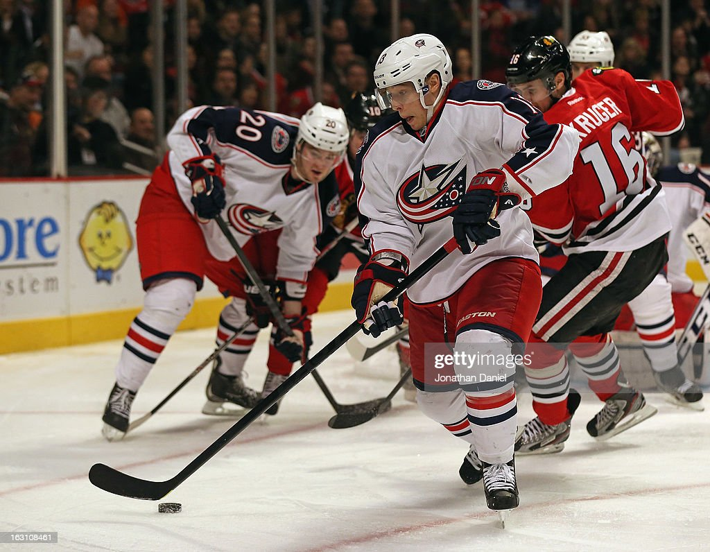 Cam Atkinson of the Columbus Blue Jackets controls the puck against the Chicago Blackhawks closes in at the United Center on March 1 2013 in Chicago...