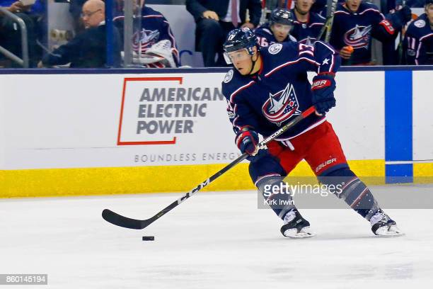 Cam Atkinson of the Columbus Blue Jackets controls the puck during the game against the New York Islanders on October 6 2017 at Nationwide Arena in...