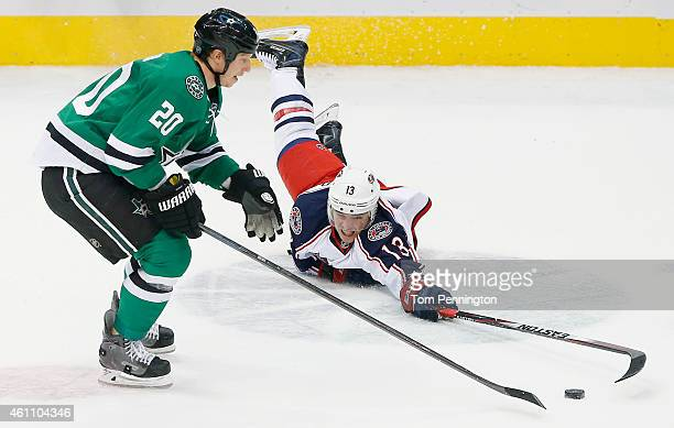 Cam Atkinson of the Columbus Blue Jackets dives for control of the puck against Cody Eakin of the Dallas Stars in the third period at American...