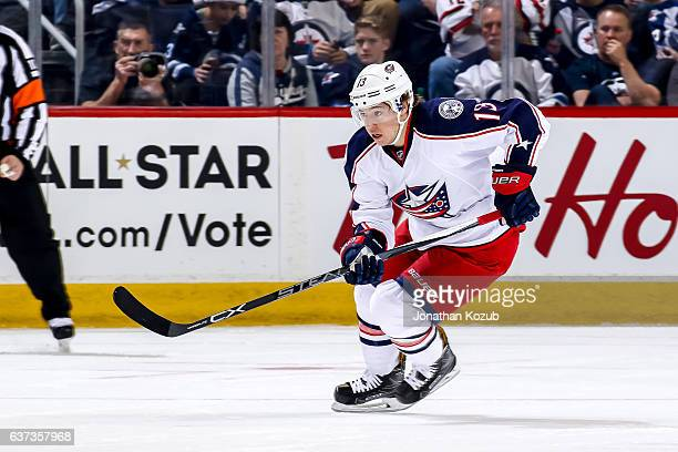 Cam Atkinson of the Columbus Blue Jackets follows the play down the ice during first period action against the Winnipeg Jets at the MTS Centre on...