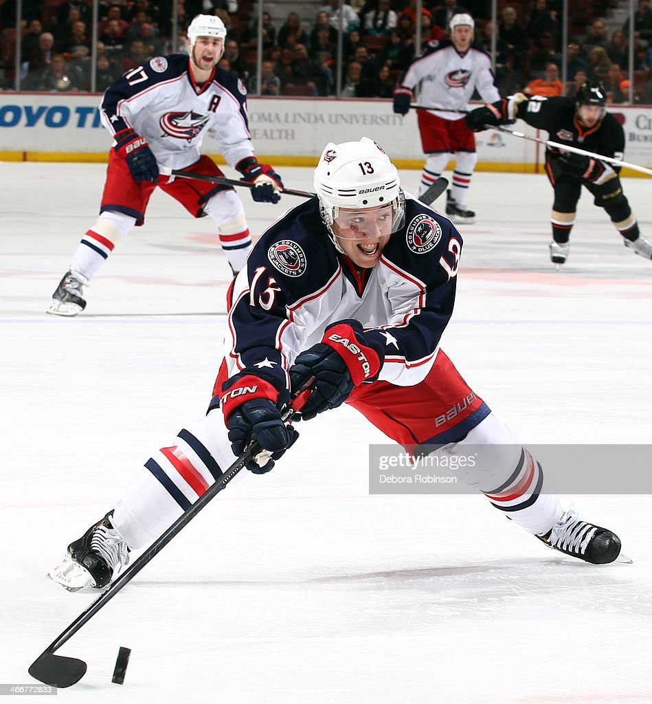 Cam Atkinson of the Columbus Blue Jackets handles the puck during the game against the Anaheim Ducks on February 3 2014 at Honda Center in Anaheim...