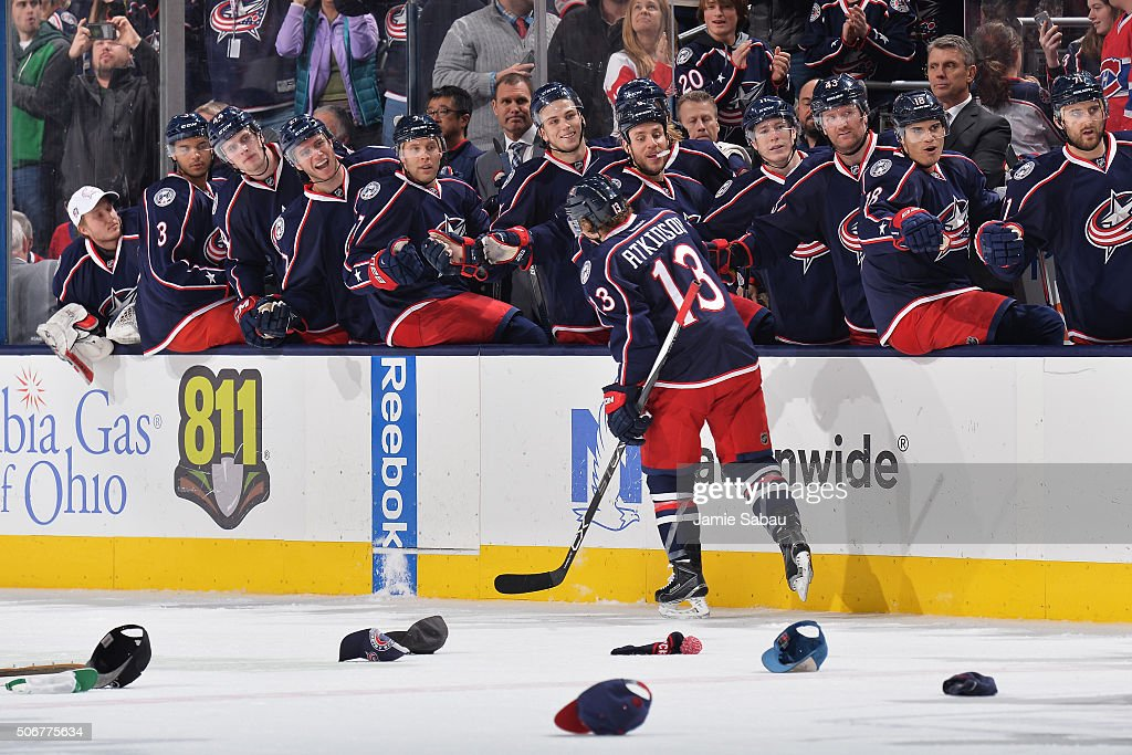 Cam Atkinson of the Columbus Blue Jackets highfives his teammates after scoring a hat trick goal during the third period of a game against the...