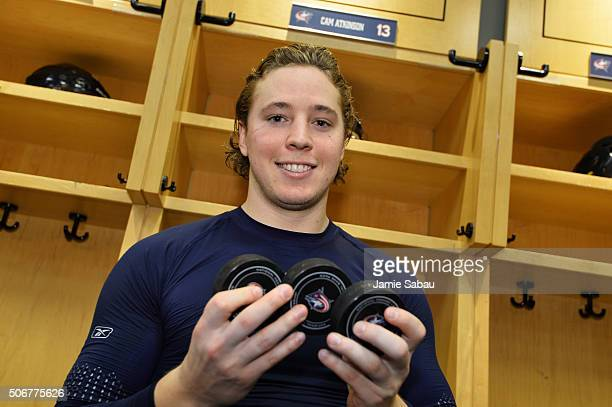 Cam Atkinson of the Columbus Blue Jackets poses with his goal pucks after scoring a hat trick in a game against the Montreal Canadiens on January 25...