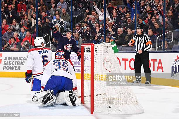 Cam Atkinson of the Columbus Blue Jackets reacts after scoring on goaltender Al Montoya of the Montreal Canadiens during the first period of a game...
