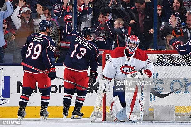 Cam Atkinson of the Columbus Blue Jackets reacts after scoring on goaltender Al Montoya of the Montreal Canadiens during the second period of a game...
