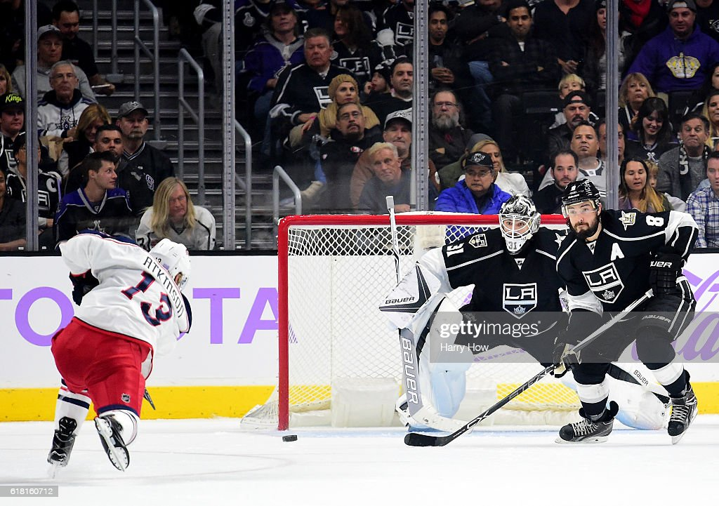 Cam Atkinson #13 of the Columbus Blue Jackets scores on a powerplay past Peter Budaj #31 and Drew Doughty #8 of the Los Angeles Kings to take a 2-1 lead during the second period at Staples Center on October 25, 2016 in Los Angeles, California.