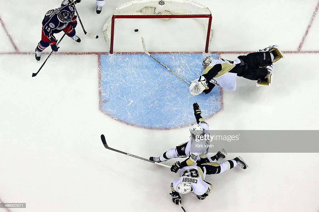 <a gi-track='captionPersonalityLinkClicked' href=/galleries/search?phrase=Cam+Atkinson&family=editorial&specificpeople=6270272 ng-click='$event.stopPropagation()'>Cam Atkinson</a> #13 of the Columbus Blue Jackets watches as Brandon Dubinsky #17 of the Columbus Blue Jackets shoots the puck past <a gi-track='captionPersonalityLinkClicked' href=/galleries/search?phrase=Sidney+Crosby&family=editorial&specificpeople=212781 ng-click='$event.stopPropagation()'>Sidney Crosby</a> #87, <a gi-track='captionPersonalityLinkClicked' href=/galleries/search?phrase=Kris+Letang&family=editorial&specificpeople=3966336 ng-click='$event.stopPropagation()'>Kris Letang</a> #58, and <a gi-track='captionPersonalityLinkClicked' href=/galleries/search?phrase=Marc-Andre+Fleury&family=editorial&specificpeople=233779 ng-click='$event.stopPropagation()'>Marc-Andre Fleury</a> #29, all of the Pittsburgh Penguins, to tie the game at three and send it into overtime during the third period in Game Four of the First Round of the 2014 NHL Stanley Cup Playoffs at Nationwide Arena on April 23, 2014 in Columbus, Ohio. Columbus defeated Pittsburgh 4-3 in overtime.