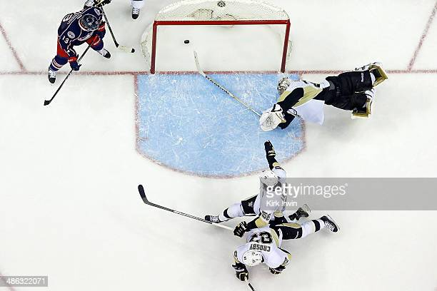 Cam Atkinson of the Columbus Blue Jackets watches as Brandon Dubinsky of the Columbus Blue Jackets shoots the puck past Sidney Crosby Kris Letang and...