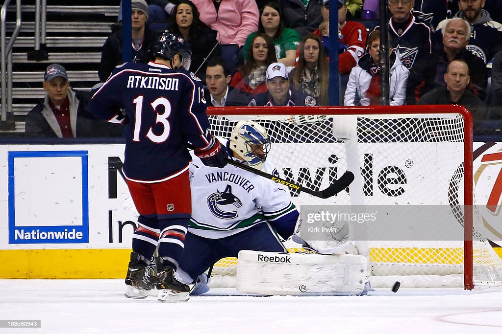 <a gi-track='captionPersonalityLinkClicked' href=/galleries/search?phrase=Cam+Atkinson&family=editorial&specificpeople=6270272 ng-click='$event.stopPropagation()'>Cam Atkinson</a> #13 of the Columbus Blue Jackets watches the rebound move wide of <a gi-track='captionPersonalityLinkClicked' href=/galleries/search?phrase=Roberto+Luongo&family=editorial&specificpeople=202638 ng-click='$event.stopPropagation()'>Roberto Luongo</a> #1 of the Vancouver Canucks during the first period on March 12, 2013 at Nationwide Arena in Columbus, Ohio.
