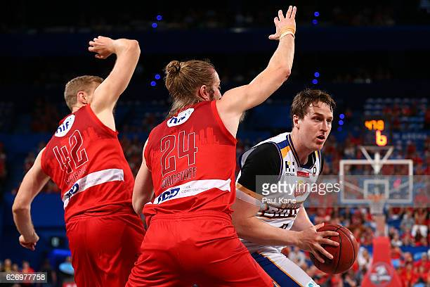 Cam Bairstow of the Bullets works to the basket against Shawn Redhage and Jesse Wagstaff of the Wildcats during the round nine NBL match between the...