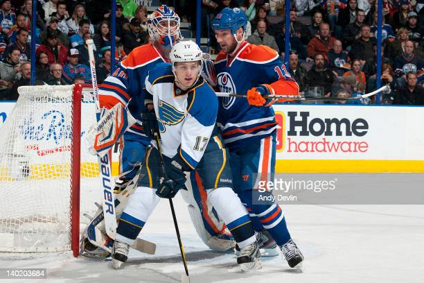 Cam Barker of the Edmonton Oilers crosschecks Vladimir Sobotka of the St Louis Blues in front of the net at Rexall Place on February 29 2012 in...