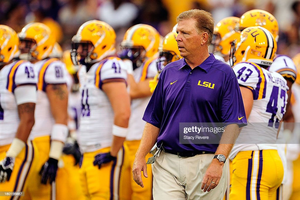 Cam Cameron, offensive coordinator of the LSU Tigers, watches his team during warmups prior to a game at Tiger Stadium against the UAB Blazers on September 7, 2013 in Baton Rouge, Louisiana. LSU won the game 56-17.