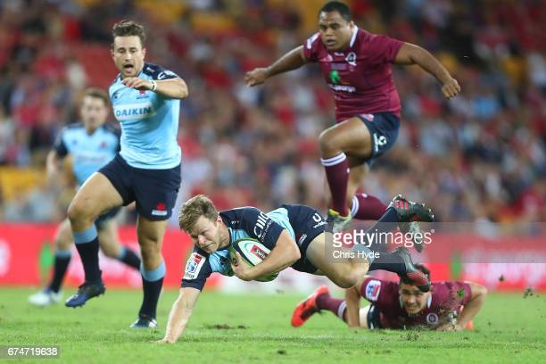 Cam Clark of the Waratahs is tackled during the round 10 Super Rugby match between the Reds and the Waratahs at Suncorp Stadium on April 29 2017 in...