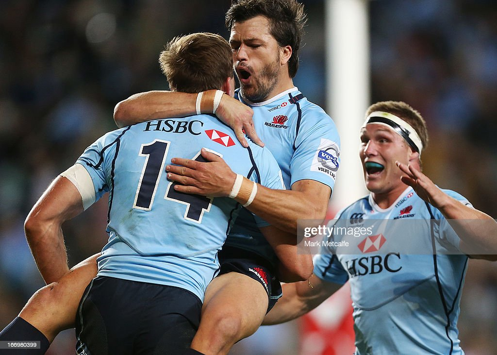 Cam Crawford of the Waratahs celebrates with <a gi-track='captionPersonalityLinkClicked' href=/galleries/search?phrase=Adam+Ashley-Cooper&family=editorial&specificpeople=637621 ng-click='$event.stopPropagation()'>Adam Ashley-Cooper</a> and Michael Hooper after scoring a try during the round 10 Super Rugby match between the Waratahs and the Chiefs at Allianz Stadium on April 19, 2013 in Sydney, Australia.